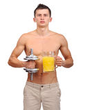 Man holding dumbbell and juice Royalty Free Stock Photography