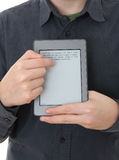 Man holding E-book reader in hands Royalty Free Stock Image