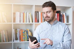Man holding an e-book reader in hands Royalty Free Stock Images