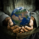 Man holding Earth Royalty Free Stock Photos