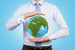 Man holding earth Stock Photo