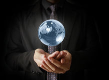 Man holding  earth. In hand Stock Photography