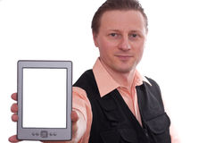 Man is holding a ebook reader into the front Royalty Free Stock Photography
