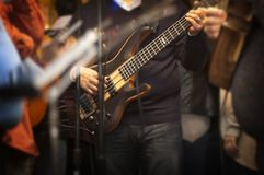 Man Holding Electric Bass Guitar stock photography