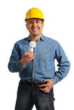 Man holding an electric bulb Royalty Free Stock Image