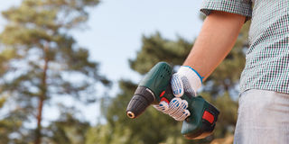 Man holding electric drill Royalty Free Stock Photography