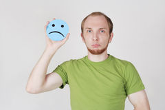 Man holding emotion sadness card Royalty Free Stock Images