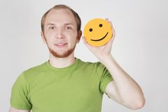 Man holding emotion smile card Royalty Free Stock Image