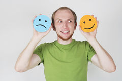 Man holding emotion smile symbols Stock Photography