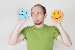 Man holding emotion smile symbols Stock Images