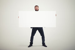 Man holding empty banner Stock Image
