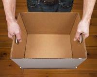 Man Holding Empty Box Stock Image