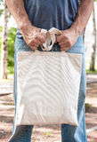 Man holding empty canvas bag. Template mock up Stock Photography