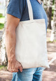 Man holding empty canvas bag. Template mock up Royalty Free Stock Images
