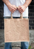 Man holding empty canvas bag Royalty Free Stock Photo