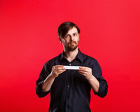 Man holding an empty copyspace Stock Image
