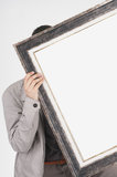 Man holding empty frame Royalty Free Stock Images