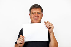 Man holding an empty poster in his hand Stock Image