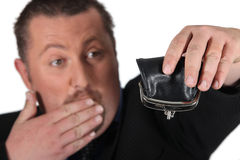 Man holding empty purse Stock Photo