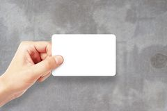 Man holding empty visiting card Royalty Free Stock Images