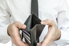 Man holding an empty wallet Royalty Free Stock Photo