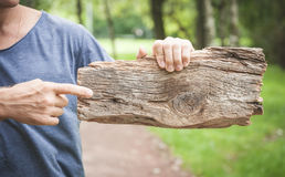 Man holding empty wooden board. Template mock up Royalty Free Stock Photo