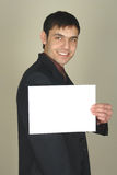 Man holding emty paper Royalty Free Stock Photo
