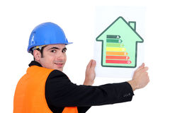 Man holding energy rating card. Shaped like a house royalty free stock photo