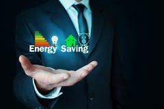 Man holding Energy Saving concept. Businessman holding Energy Saving concept stock photo