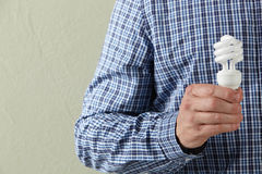Man Holding Energy Saving Lightbulb Stock Photos