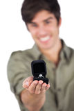 Man holding an engagement ring Royalty Free Stock Photos