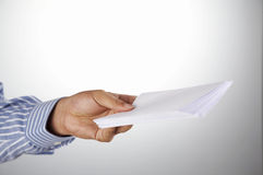 Man holding  envelop Stock Images
