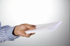 Man holding envelop stock images
