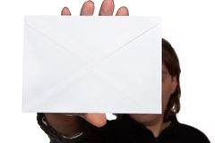 Man holding envelope Stock Images