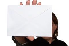 Man holding envelope Stock Images