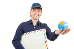 Man holding an envelope and a small globe Royalty Free Stock Photos