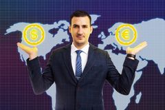 Man holding euro and dollar symbols in palms. Man working at business stock market holding euro and dollar symbols in palms as economical balance concept with stock photos