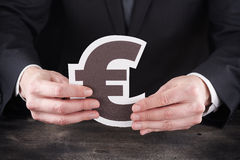 Man holding euro icon in hands Stock Images