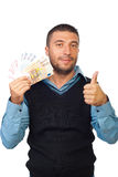 Man holding euro money and give thumbs Royalty Free Stock Photos
