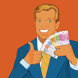 Man Holding Euros. White Man Holding Euros and giving thumbs up Stock Photo