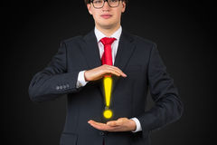 Man holding exclamation mark Royalty Free Stock Photos