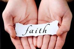 Man holding faith word stock photo