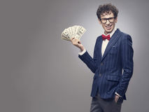Man holding fan of dollar banknotes Stock Images