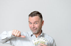 Man Holding a Fan of Five Euro Notes Royalty Free Stock Images