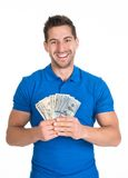 Man holding fanned us paper currency Royalty Free Stock Photos