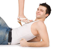 Man holding female leg in high heels Royalty Free Stock Images