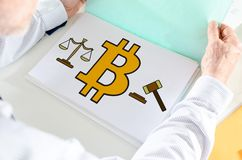 Bitcoin regulation concept on a paper. Man holding a file with bitcoin regulation concept royalty free stock photography