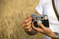 Man holding film camera Royalty Free Stock Image