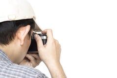 Man holding film camera ready to take photo Stock Photos