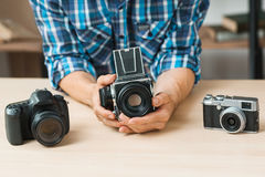 Man holding film photo camera in hands Royalty Free Stock Photos